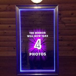 Meet the newest member of our family! Our Mirror Booth looks like a full length mirror with a digital camera behind the glass to take your selfie while images flash with instructions and words of encouragement.