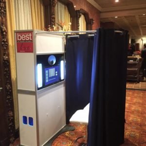 Our Classic Photo Booth package includes our curtain enclosure (different colors available). The curtain rods are removable so you have the option to have it open air with either a backdrop or nothing at all.